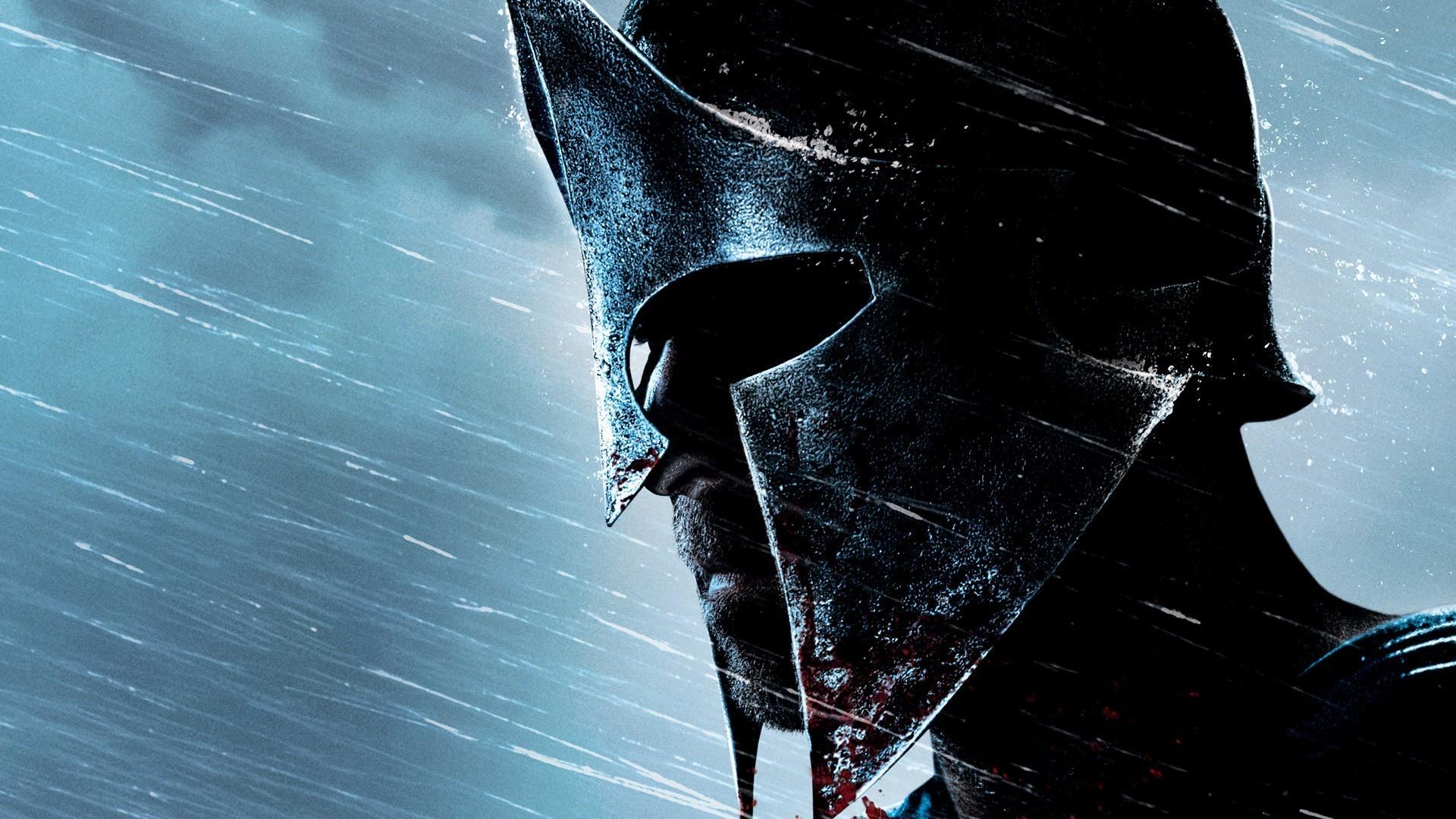 Спартанец в шлеме под дождем обои скачать