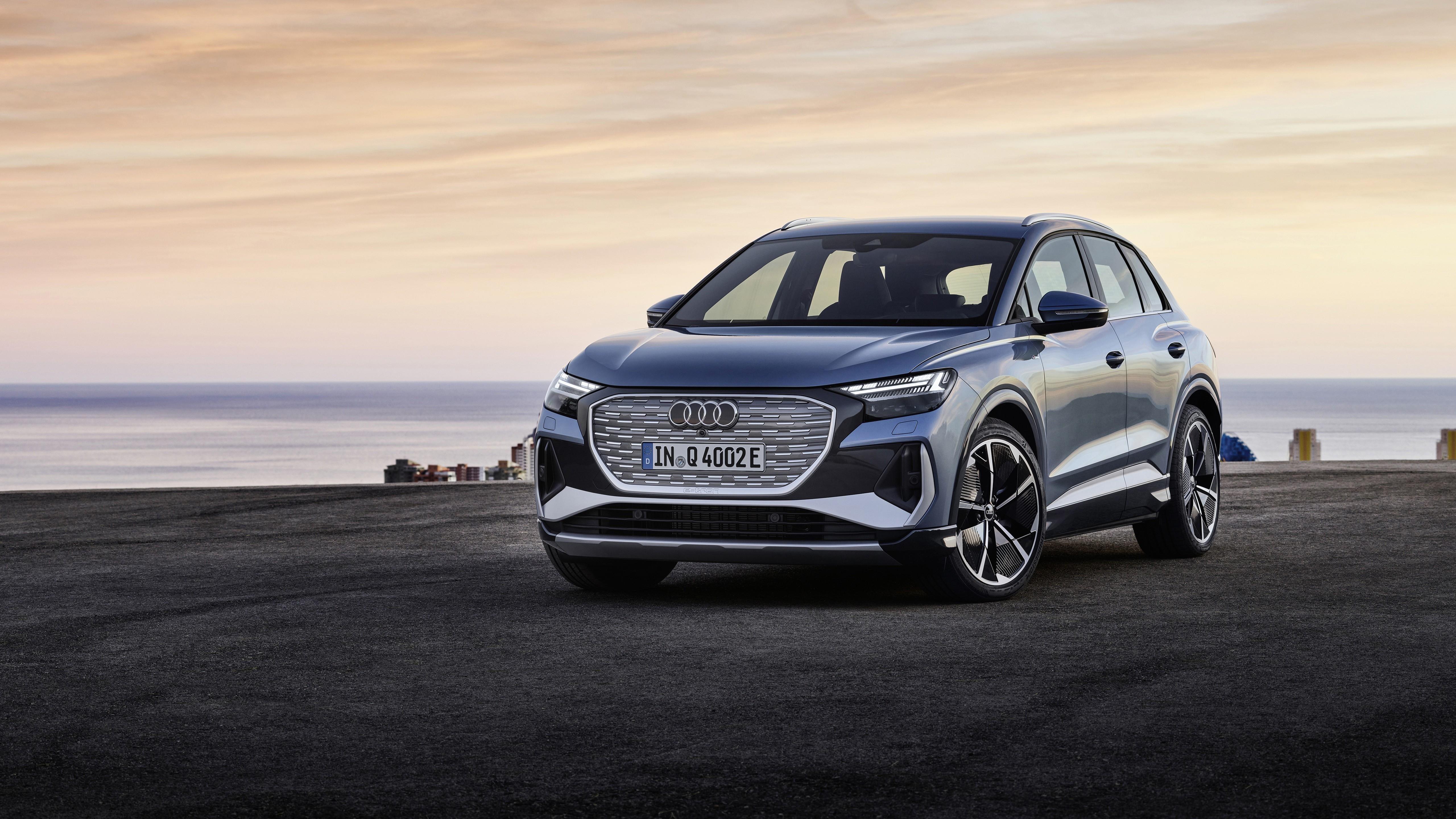 Audi q4 50 e tron s line 2021 2 автомобиля обои скачать