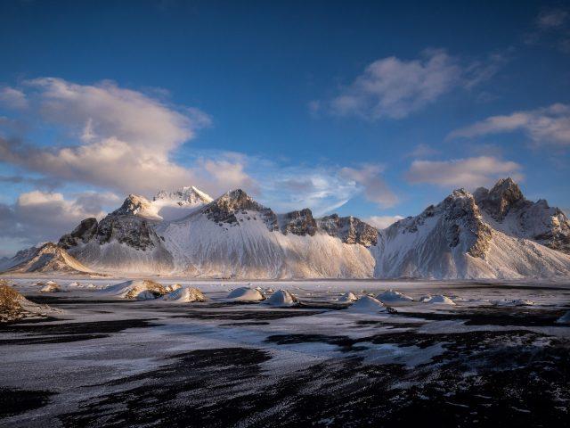 Хофн Вестрахорн облака Исландия заснеженные горы природа