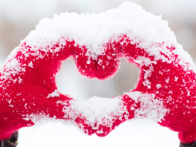Love heart snow hands.