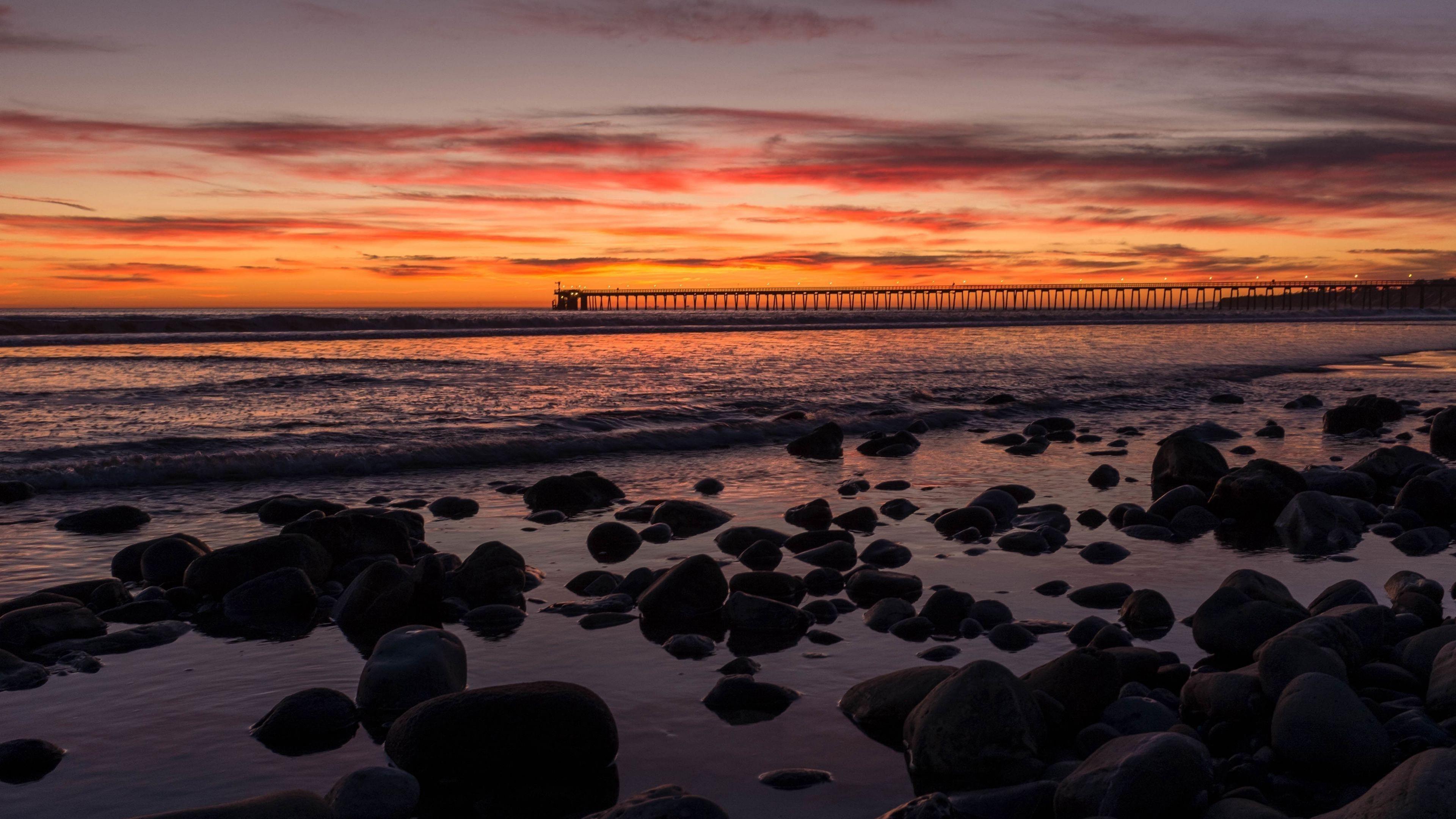 Закат, мост, море, скалы, облака обои скачать