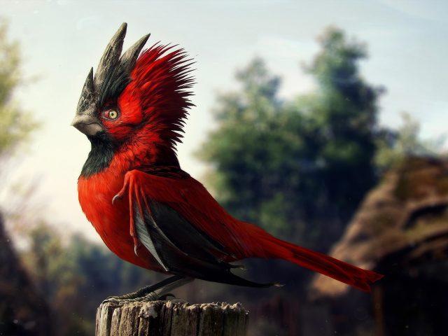 Красно черная птица стоит на стволе дерева в сине зеленом фоне деревьев животные