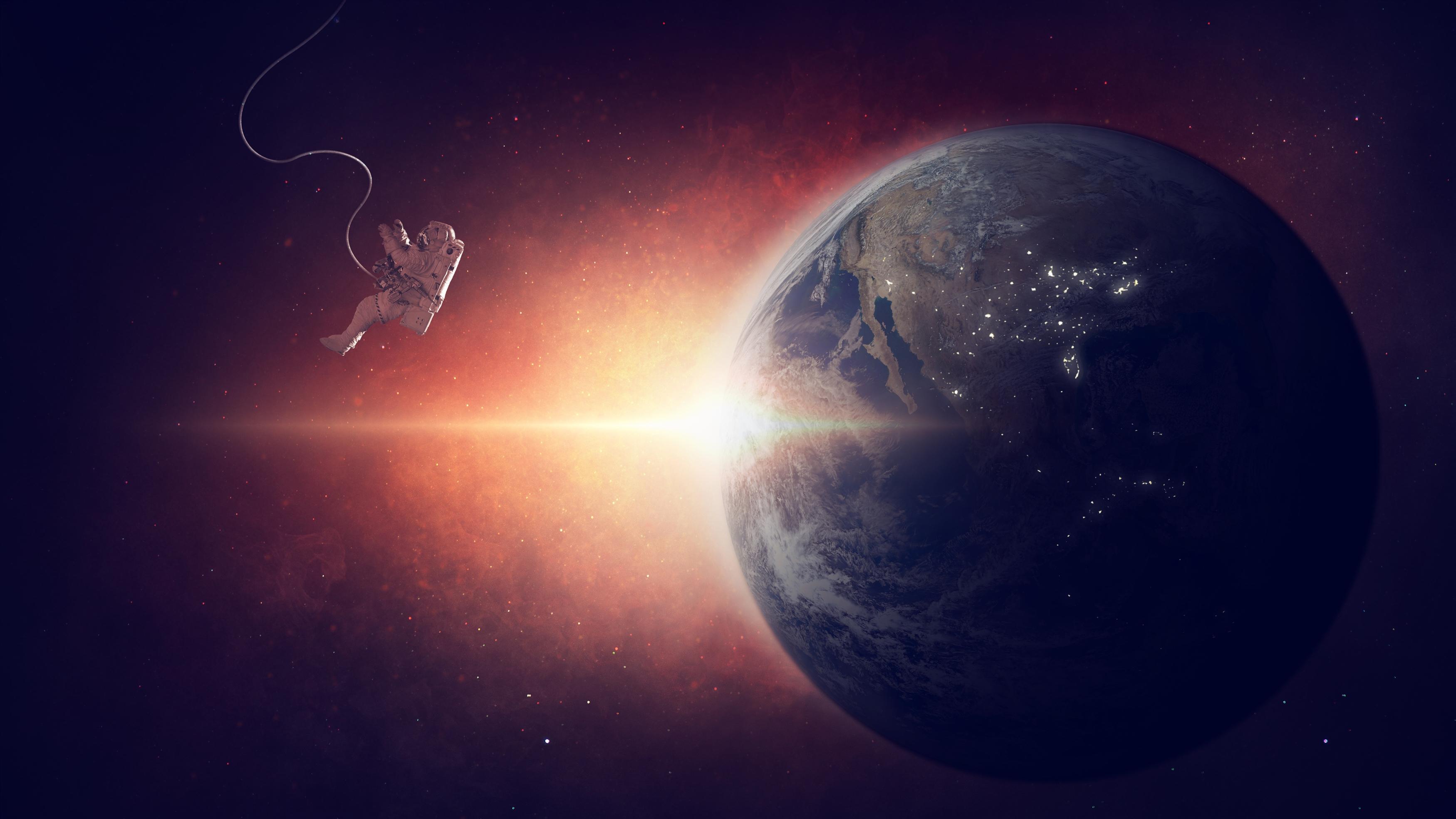 Космонавт на орбите обои скачать